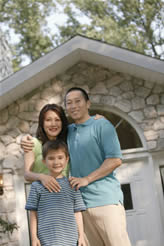 Asian Family In front of new home